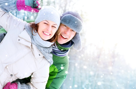 Happy Couple Having Fun Outdoors  Snow  Winter Vacation