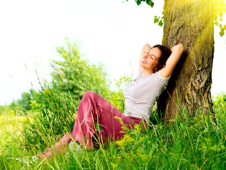 Photo for Beautiful Young Woman Relaxing outdoors  Nature  - Royalty Free Image