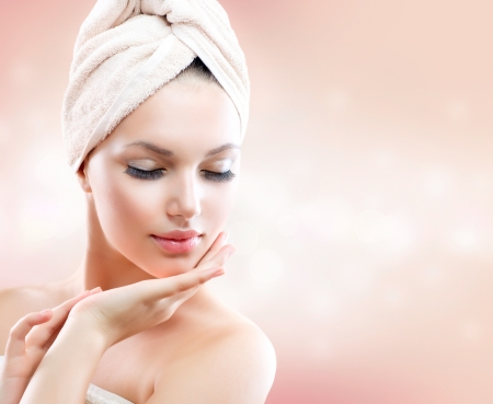 Photo pour Beautiful Girl After Bath Touching Her Face  Skincare - image libre de droit