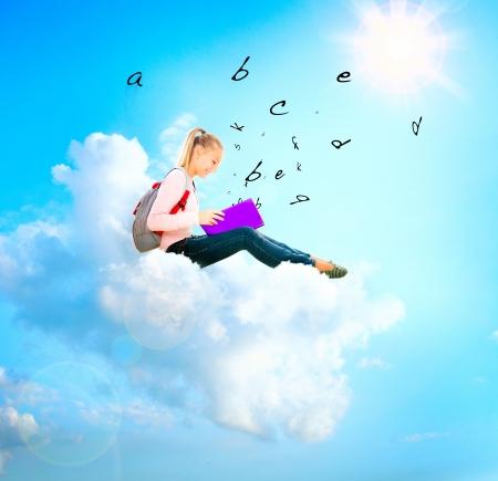 Photo pour School Girl or Student on a Cloud Reading a book  Education  - image libre de droit