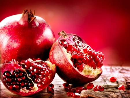 Pomegranates over Red Background  Organic Bio fruits