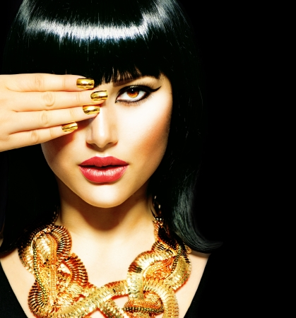 Beauty Brunette Egyptian Woman Golden Accessories Beauty Brunette Egyptian Woman  Golden Accessories
