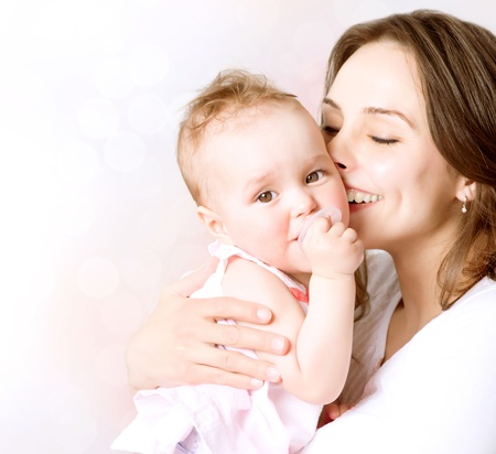 Photo pour Mother and Baby kissing and hugging  Happy Family  - image libre de droit