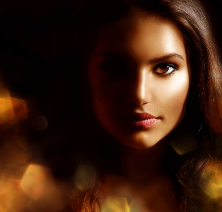 Beauty Girl Dark Portrait with Golden Sparks  Mysterious Woman