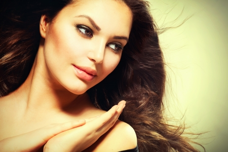 Beautiful Brunette Woman with Blowing Healthy Hair