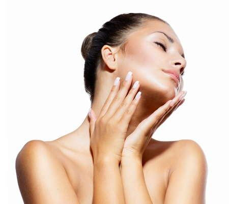 Photo for Beauty Portrait  Beautiful Spa Woman Touching her Face - Royalty Free Image