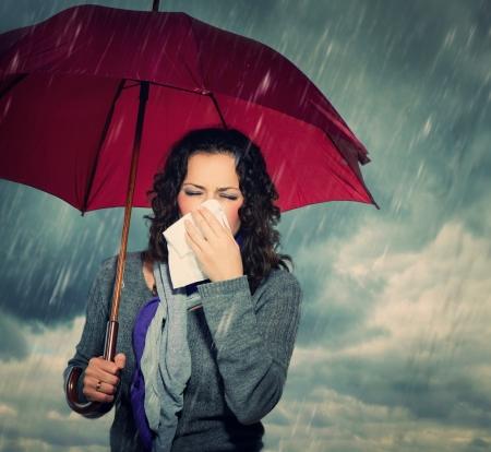 Sneezing Woman with Umbrella
