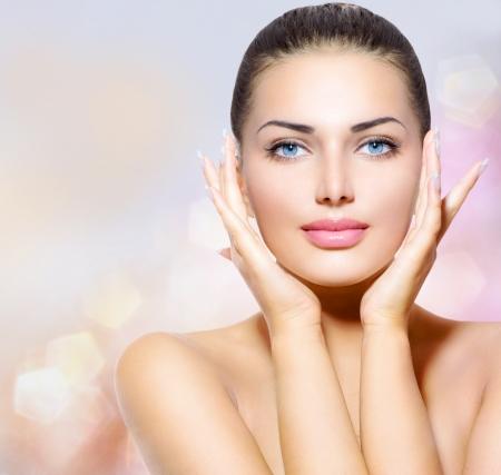 Beauty Portrait  Beautiful Spa Woman Touching her Face