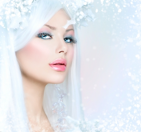Winter Beauty  Beautiful Fashion Model Girl with Snow Hairstyle