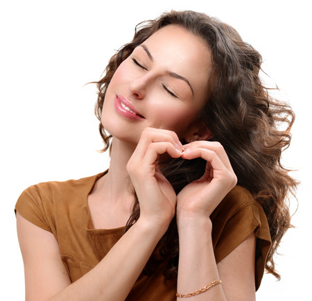 Photo pour Woman in love showing Heart with her Hands  St  Valentine s Day - image libre de droit
