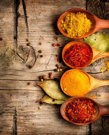 Spices and herbs  Curry, saffron, turmeric, cinnamon over wood