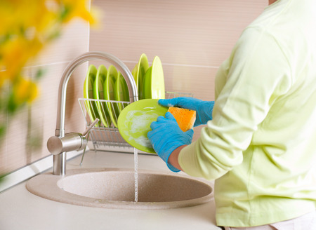 Woman Washing Dishes  Kitchen  Dishwashing
