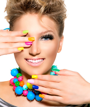 Foto de Beauty Girl with Colorful Makeup, Nail polish and Accessories - Imagen libre de derechos