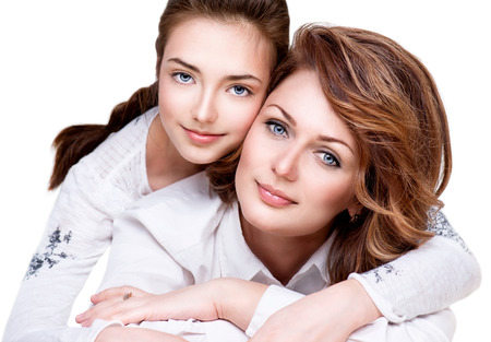 Close-up Portrait of Mother and her Teenage Daughter
