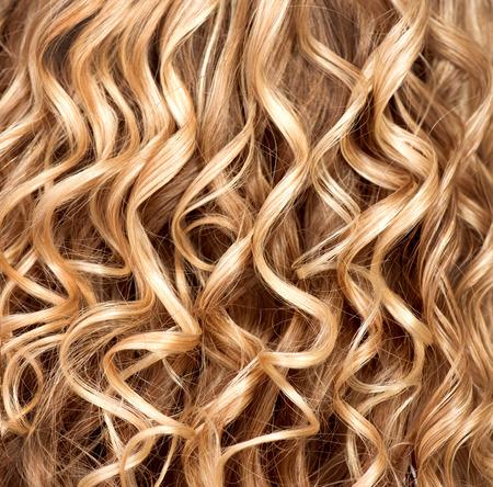 Wavy curly blonde hair closeup  Texture of permed hair