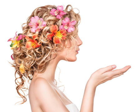 Beauty girl with flowers hairstyle and open handsの写真素材
