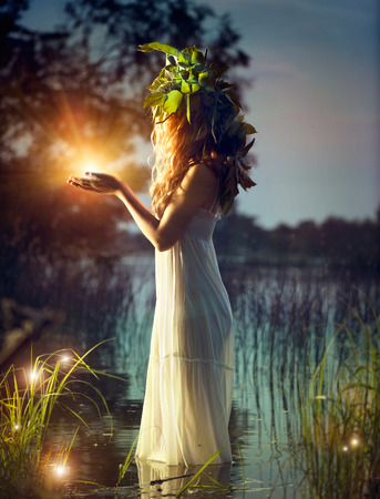 Fantasy girl taking magic light  Mysterious night scene