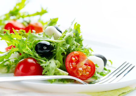 Salad with Mozzarella Cheese isolated on white background