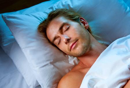 Photo pour Young Man Sleeping in his Bed - image libre de droit