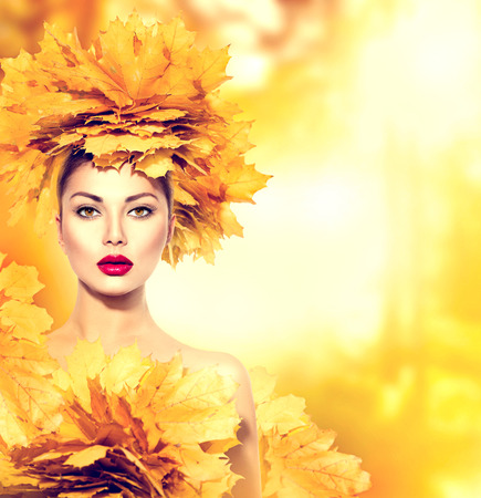 Photo pour Autumn woman with yellow leaves hairstyle. Fall. Creative makeup - image libre de droit