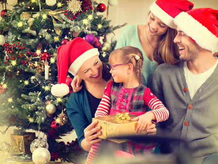 Happy Smiling Family at Home Celebrating Christmas