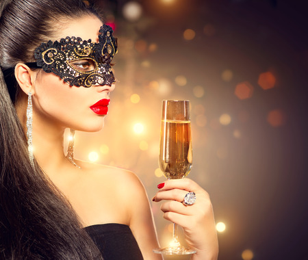 Photo for Sexy model woman wearing carnival mask with glass of champagne - Royalty Free Image