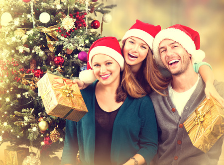 Christmas Family Portrait. Smiling Parents with Teenage Daughterの写真素材