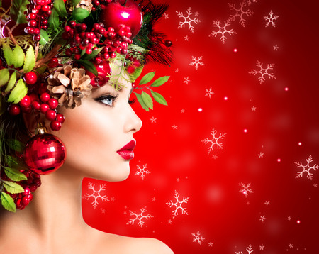 Christmas Winter Woman. Beautiful Christmas Holiday Hairstyleの写真素材