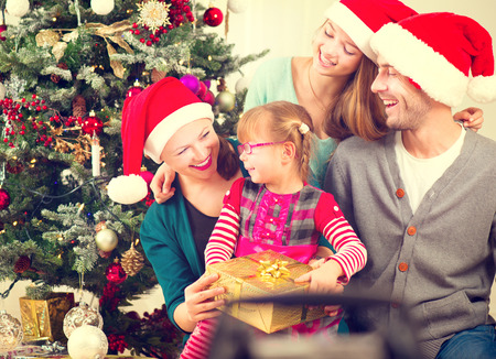 Christmas family with kids opening christmas giftsの写真素材