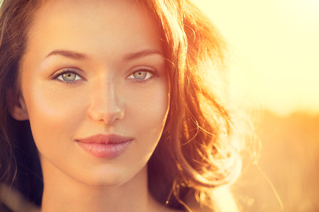 Photo for Beauty girl outdoors. Teenage girl smiling in sun light - Royalty Free Image