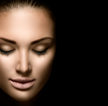 Beauty woman face closeup isolated on black backgroundの写真素材