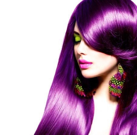 Beautiful brunette girl with healthy long purple hair
