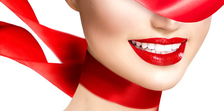 Photo pour Beautiful model girl with red lips and blowing red silk scarf - image libre de droit