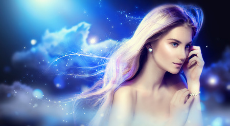 Beauty fantasy girl with long blowing hair over night sky