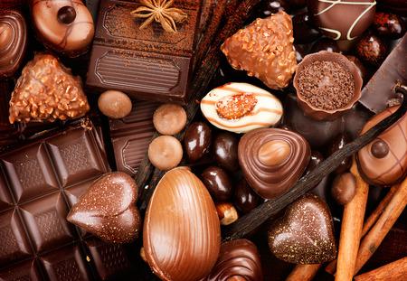 Photo pour Chocolates background. Praline chocolate sweets - image libre de droit