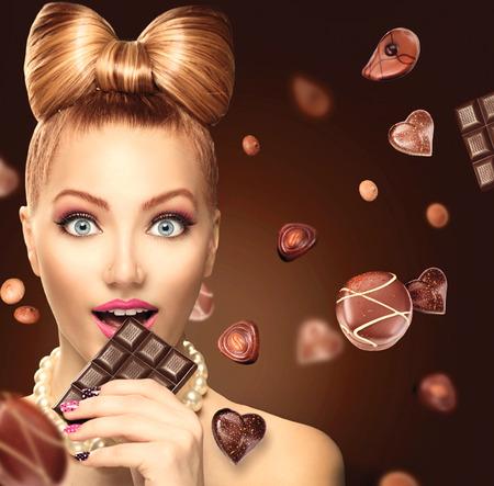Foto de Beauty fashion model girl eating chocolate - Imagen libre de derechos
