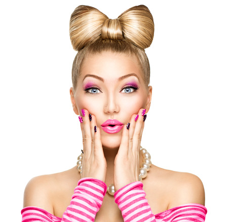 Beauty surprised fashion model girl with funny bow hairstyleの写真素材