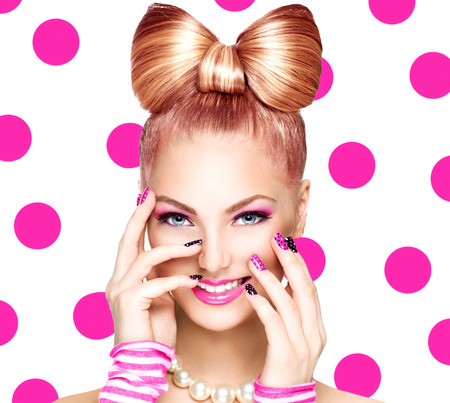 Beauty fashion model girl with funny bow hairstyleの写真素材