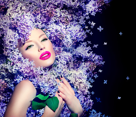 Foto per Beauty fashion model girl with lilac flowers hairstyle - Immagine Royalty Free