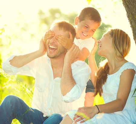 Happy joyful young family having fun outdoors