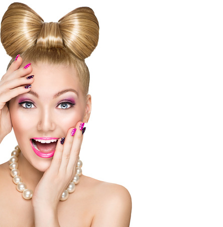 Beauty surprised model girl with funny bow hairstyleの写真素材