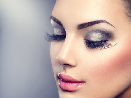 Beautiful fashion luxury makeup. Long eyelashes, perfect skinの写真素材