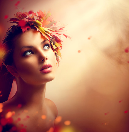 Photo for Romantic autumn girl with colorful yellow and red leaves on her head - Royalty Free Image