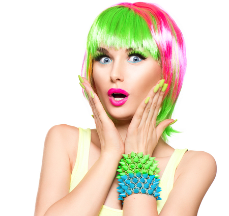 Surprised beauty fashion model girl with colorful dyed hairの写真素材