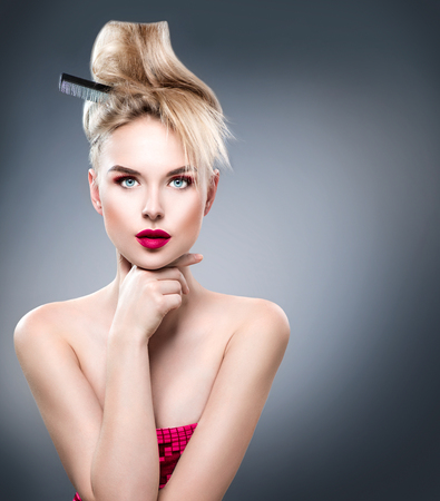 Beauty woman with modern hairstyle and perfect glamour makeup