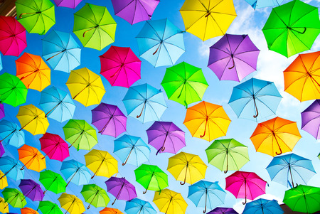 Foto de Hanging multicolored umbrellas over blue sky. Abstract background - Imagen libre de derechos