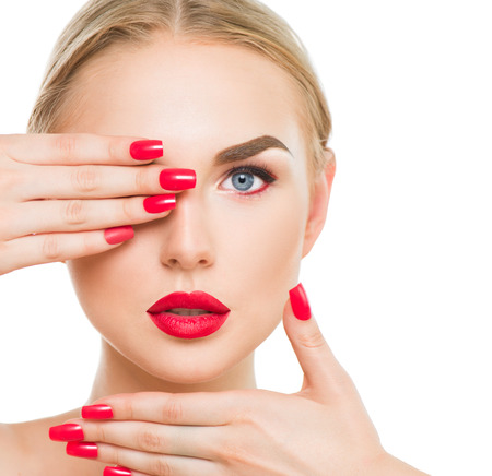 Beauty blond fashion model with red lipstick and red nailsの写真素材