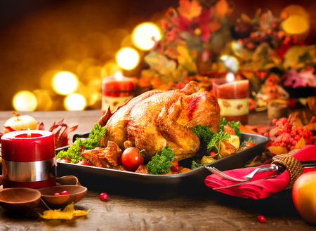 Photo pour Thanksgiving dinner table served with turkey, decorated with bright autumn leaves - image libre de droit