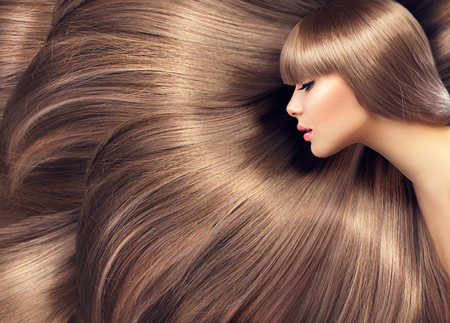 Beautiful hair. Beauty woman with shiny long hair as backgroundの写真素材
