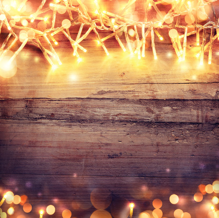 Christmas wooden background with light garland